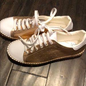 Andrew Stevens rose gold tennis shoe